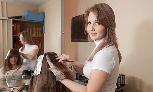 Hairdresser coloring   girl hair